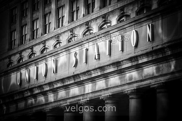 Union Station Chicago sign and building in black and white. Union Station opened in 1925 and serves as a train station for commuter trains. (Paul Velgos)