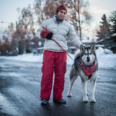 CPA Nathalie Martin with her five year old malamut, Kodi, out for a run on G Street in Anchorage's South Addtion Neighborhood (© Clark James Mishler)