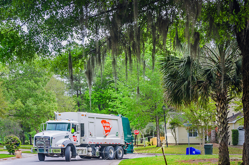 Carolina Waste employees empty trash in the Shadowmoss subdivision, April 7, 2015, in Charleston, S.C. Approximately 95 percent of the 60-truck fleet is comprised of Macks. The company was founded in 2002 and is the largest independently owned waste hauling company in the state. (Photo by Carmen K. Sisson/Cloudybright) (Carmen K. Sisson/Cloudybright)