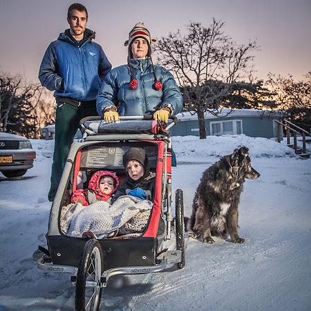 "Physical theropist Sara Falkoff with her husband Will Marshall , son Nick (3) and daughter Ali (9 months) near their home in Bootleggers Cove, Anchorage.  ""We love our circle of Friends in Anchorage."" saraalaska@hotmail.com (© Clark James Mishler)"