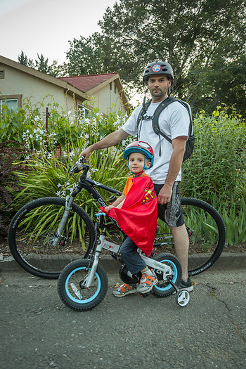 Wine advisor Cory Johnston with his three year old son, Jaxson, take an after dinner bike ride (Clark James Mishler)