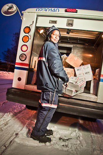 Letter carrier, Queen Stewart, handles holiday packages for delivery in South Addition, Anchorage (Clark James Mishler)