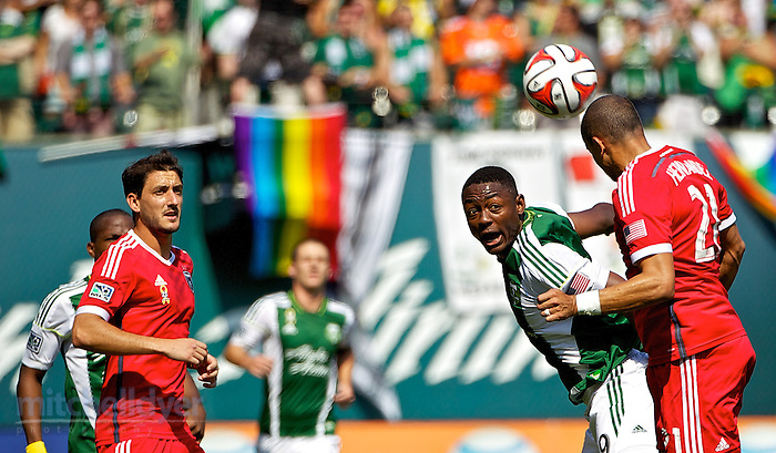 September 7, 2014; Portland, OR, USA; Portland Timbers forward Fanendo Adi (9) heads the ball at Providence Park. Photo: Craig Mitchelldyer-Portland Timbers (Craig Mitchelldyer)