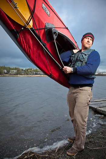 Steve Conway tests his Foldboat in Anchorage's Westchester Lagoon (Clark James Mishler)