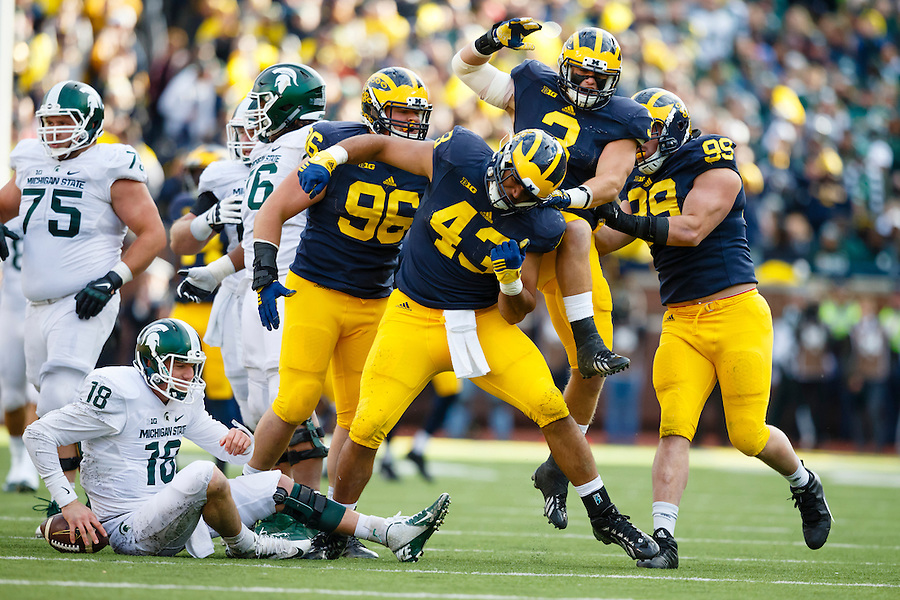 Oct 17, 2015; Ann Arbor, MI, USA; Michigan Wolverines defensive end Chris Wormley (43) celebrates his sack of Michigan State Spartans quarterback Connor Cook (18) in the first half at Michigan Stadium. Mandatory Credit: Rick Osentoski-USA TODAY Sports (Rick Osentoski/Rick Osentoski-USA TODAY Sports)