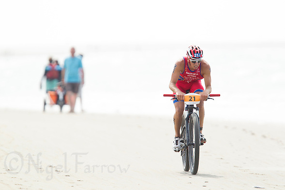 13 JUL 2013 - DEN HAAG, NED - Ruben Ruzafa (ESP)  of Spain cycles along the beach during the 2013 ITU Elite Men's Cross Triathlon World Championships in Kijkduin in Den Haag (The Hague), the Netherlands (PHOTO COPYRIGHT © 2013 NIGEL FARROW, ALL RIGHTS RESERVED) (NIGEL FARROW/COPYRIGHT © 2013 NIGEL FARROW : www.nigelfarrow.com)