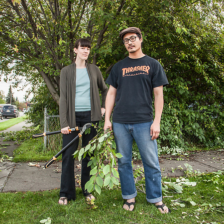 Kim and Ted Kim trim their May Tree in Anchorage's South Addition neighborhood. (Clark James Mishler)
