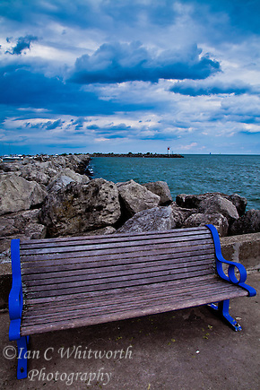 Bronte Harbour bench in Oakville with a interesting sky in the background (Ian C Whitworth)