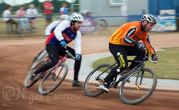 12 JUL 2015 - IPSWICH, GBR - Lee Aris (right) of Wednesfield Aces attempts to hold off Josh Brooke of Ipswich Eagles during their Elite League cycle speedway fixture at Whitton Sports and Community Centre in Ipswich, Suffolk, Great Britain (PHOTO COPYRIGHT © 2015 NIGEL FARROW, ALL RIGHTS RESERVED) (NIGEL FARROW/COPYRIGHT © 2015 NIGEL FARROW : www.nigelfarrow.com)