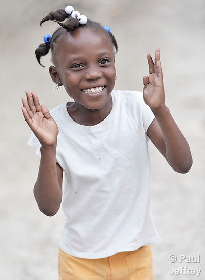 Francisca Mezunet, an 8-year old earthquake survivor, participates in activities at a youth center run by the YWCA in Petionville, Haiti. The program educates and empowers girls, many of whom don't go to school, who come from families affected by the January 2010 earthquake. Many live in tents that fill a nearby park.