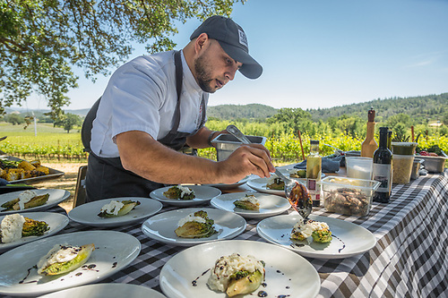 Executive Chef Alex Espinoza prepares food for a wine country familiarization trip for visitor industry professionals at Peju Winery in Pope Valley organized by Revealed Enterprises (Clark James Mishler)