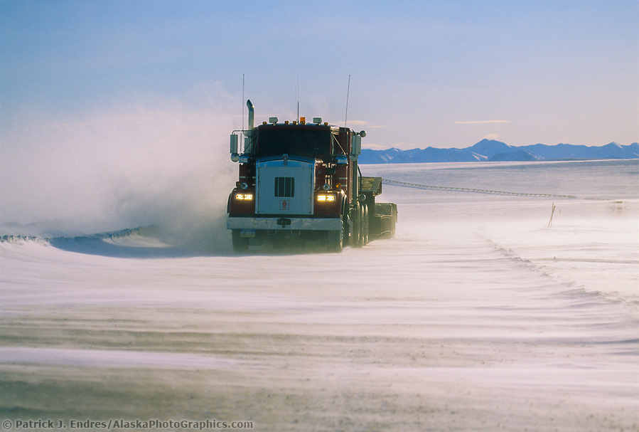 Trucking photos: Semi travels the dalton highway during high winds and blowing snow, north of the Brooks Range, on Alaska's Arctic coastal plains. (Patrick J. Endres / AlaskaPhotoGraphics.com)