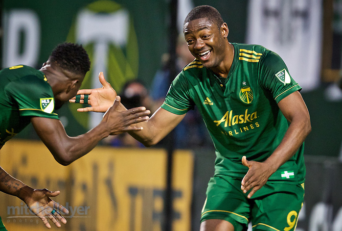 June 10, 2017; Portland, OR, USA; Portland Timbers forward Fanendo Adi (9) and midfielder Dairon Asprilla (27) high five after Adi scored his second goal of the match at Providence Park. Photo: Craig Mitchelldyer-Portland Timbers (Craig Mitchelldyer)