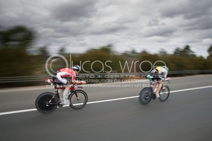 David Dellow (AUS) Passes Axel Zeebroek (BEL), March 23, 2014 - Ironman Triathlon : Bike Course. Ironman Melbourne Race, Bike Cycle Course Between Frankston And Ringwood Tunnel, Melbourne, Victoria, Australia. Credit: Lucas Wroe (Lucas Wroe)