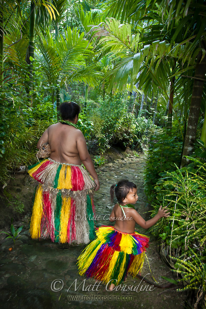 Mother and daughter taking an ancient traditional stone path through the forest to the village house. Yap Micronesia (Photo by Matt Considine - Images of Asia Collection) (Matt Considine)