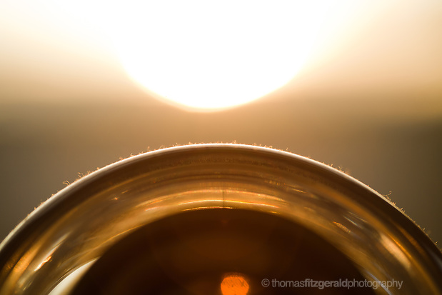 An abstract image of the sun illuminating a polycarbonate see through Apple speaker creating an image that almost looks like a planet and a distant sun (Thomas Fitzgerald)