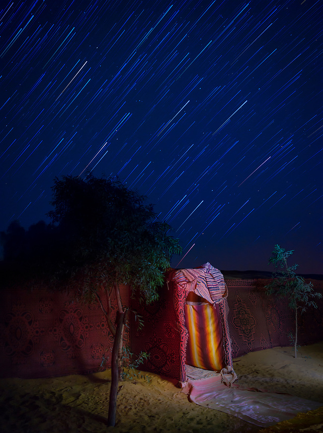 MEKNES - TAFILALET, MOROCCO - CIRCA APRIL 2017: Star trails over a Berber camp in the Sahara Desert (Daniel Korzeniewski)