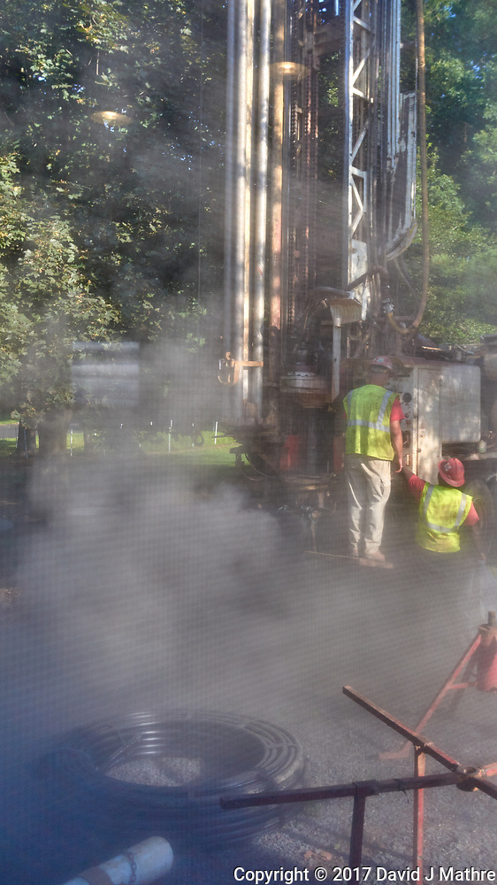 Two wells being drilled for a closed loop geothermal heat exchange pipe. Image taken with a Leica T camera and 23 mm f/2.8 or 11-23 mm lens. (David J Mathre)