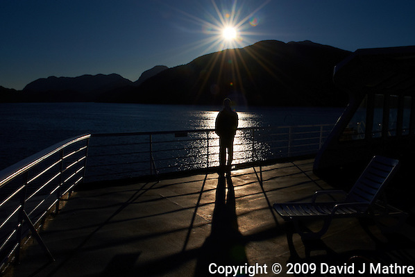 Silhouette, Shadow, and Sunburst on the MV Columbia Alaska Marine Highway Between Bellingham, Washington and Haines, Alaska -- Queen Charlotte Sound, British Columbia - Canada. Image taken with a Nikon D3 camera and 24-70 mm f/2.8 lens (ISO 200, 24 mm, f/22, 1/1000 sec). (David J Mathre)