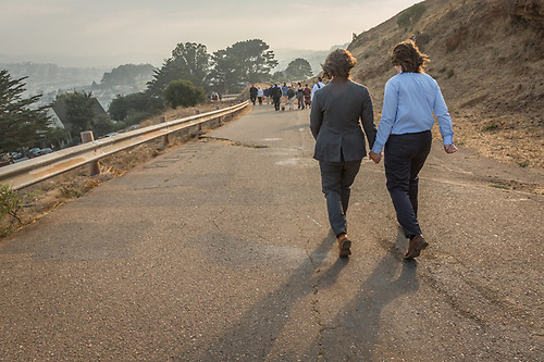 Olivia and Elyse walk together after their marriage atop Burnal Hill in San Francisco. (Clark James Mishler)