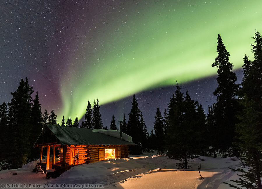 Northern lights over a rustic log cabin in the Alaska Range mountains, Interior, Alaska. (Patrick J Endres / AlaskaPhotoGraphics.com)