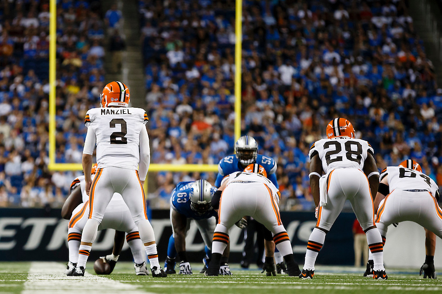 Cleveland Browns quarterback Johnny Manziel (2) gets set to run a play against the Detroit Lions during a preseason NFL football game at Ford Field in Detroit, Saturday, Aug. 9, 2014. (AP Photo/Rick Osentoski) (Rick Osentoski/AP)