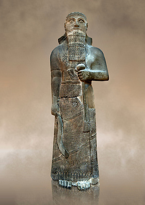 """Neo-Assyrian basalt statue of King Shalmaneser III (858-824 B.C) . Inscription reads """"Shalmaneser, the great king, the mighty king, king of all four region, the powerful and the mighty rival of the princes of the whole earth the great ones, the kings, son of Assur-Nasirapli, King of the universe, King of Assyria, grandson of ~Tukultiu-Ninurta, King of the Universe, King of Assyria"""". The inscription continues with his campaigns &b deeds in Uratu, Syria, Que & Tabal ending """" At the time I rebuilt the walls of my city Ashur from their foundations to their summits. I made an image of my royal self and set it up in the metal gate"""". From Assur ( Qala't Sharqat) Iraq. Istanbul Archaeological Museum, Inv no. 4650. (Paul Williams)"""