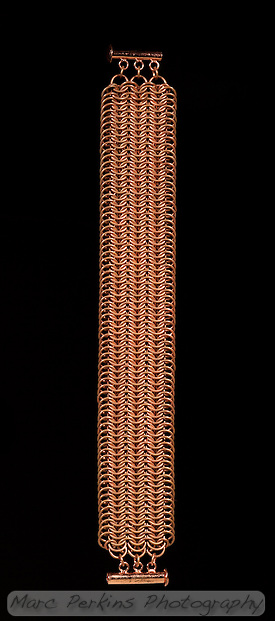 A european 8-in-1 copper chainmail bracelet with a sliding clasp.