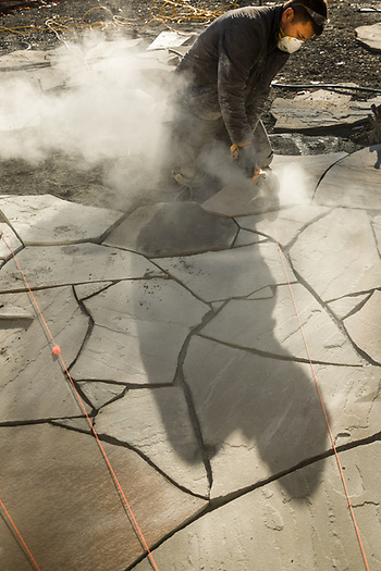 """It's like a giant puzzle and it took me a while to learn how to make the pieces fit together...still, cutting is necessary.""    -Stone Mason Antonio Baltista fashions a stone entrance at a home on Cedar Street in Calistoga. (Clark James Mishler)"