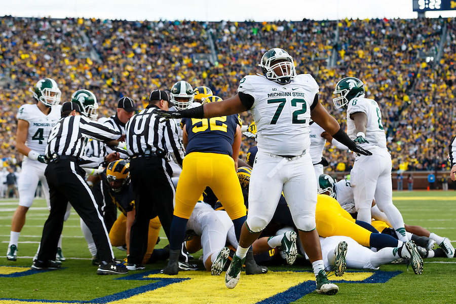 Oct 17, 2015; Ann Arbor, MI, USA; Michigan State Spartans defensive tackle Craig Evans (72) celebrates what he thinks is a goal line stand before a touchdown is awarded to the Michigan Wolverines at Michigan Stadium. Mandatory Credit: Rick Osentoski-USA TODAY Sports (Rick Osentoski/Rick Osentoski-USA TODAY Sports)