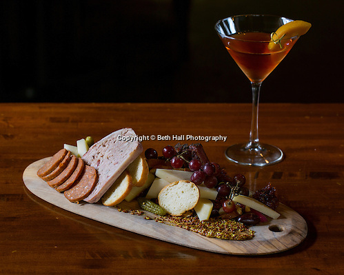 A Charcuterie and Cheese Board with a Peach Whiskey Manhatten at Tusk and Trotter on Friday, February 19, 2016, in Bentonville, Arkansas. Beth Hall for the New York Times (Beth Hall)