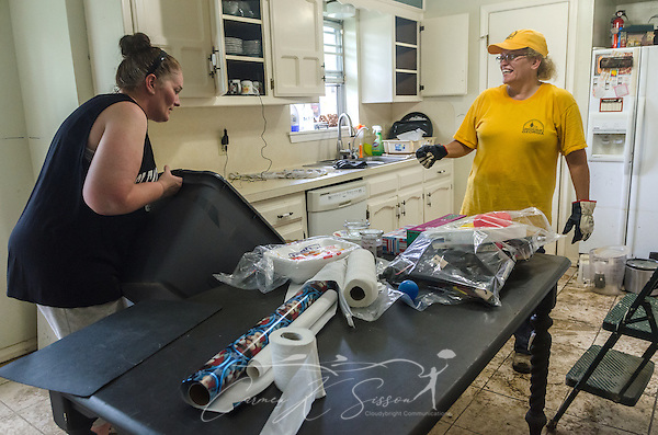 Southern Baptist Disaster Relief volunteer Kim Rowland, a member of East Dublin Dayspring Worship Center in East Dublin, Ga., helps clean the kitchen with homeowner Karen Johnson, of Immaculate Conception Church, Aug. 26, 2016, in Denham Springs, La. Rowland, along with other SBDR Georgia volunteers, is at Johnson's home this week, helping her mud out the flood-damaged house. Johnson is among thousands of Louisiana residents affected by a mid-August flood. (Photo by Carmen K. Sisson) (Carmen K. Sisson/Cloudybright)