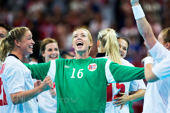 11 AUG 2012 - LONDON, GBR - Katrine Lunde Haraldsen (NOR) (centre) of Norway celebrates winning the women's London 2012 Olympic Games handball final against Montenegro at the Basketball Arena in the Olympic Park, in Stratford, London, Great Britain .(PHOTO (C) 2012 NIGEL FARROW) (NIGEL FARROW/(C) 2012 NIGEL FARROW)
