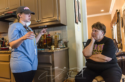 Sarah Farley, associate director of Louisiana State University's Baptist Collegiate Ministry, discusses mold removal with homeowner Paulette LaCombe, Sept. 3, 2016, at a flood-damaged home in Denham Springs, La. Farley helped organize a massive mud out event, bringing more than 450 student members of LSU Baptist Collegiate Ministry and other collegiate church ministries from six states, to help survivors of the mid-August flood.  (Photo by Carmen K. Sisson) (Carmen K. Sisson/Cloudybright)