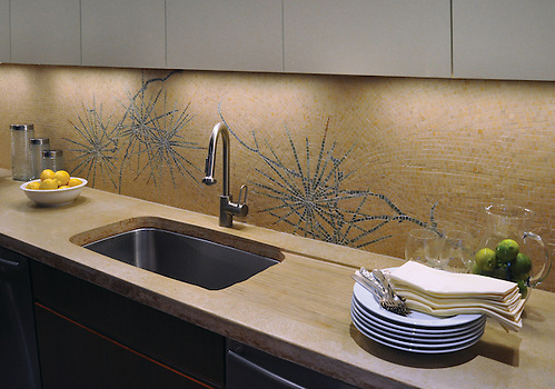 Ikebana backsplash shown in Lagos Gold honed and Verde Luna, Topaz Onyx, Travertine Noce polished (New Ravenna Mosaics)