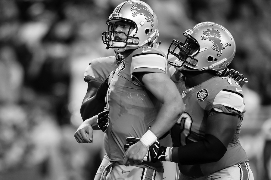 Detroit Lions quarterback Matthew Stafford, left, celebrates his rushing touchdown during the second half of an NFL football game against the Oakland Raiders, Sunday, Nov. 22, 2015, in Detroit. (AP Photo/Rick Osentoski) (Rick Osentoski/AP)