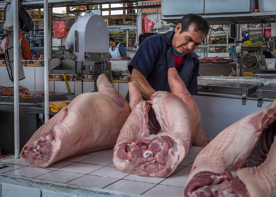AREQUIPA, PERU - CIRCA APRIL 2014: Butcher at the San Camilo market in Arequipa. Arequipa is the Second city of Perú by population with 861,145 inhabitants and is the second most industrialized and commercial city of Peru. (Daniel Korzeniewski)