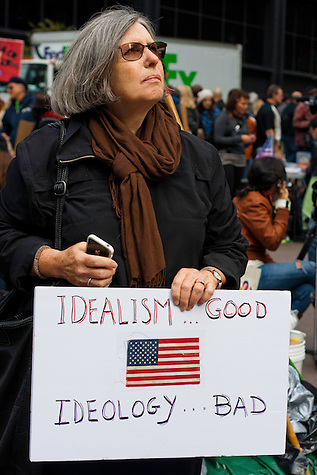Protester holds up a sign at the Occupy Wall Street demonstration in Zuccotti Park. October 21, 2011. (Emon Hassan)