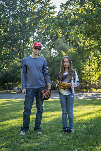 """I want to play professional baseball...men's professional baseball and I want to pitch.""  -Ten year old Afton Parks with her father, Christian after a game of catch at Calistoga Elementary school (Clark James Mishler)"