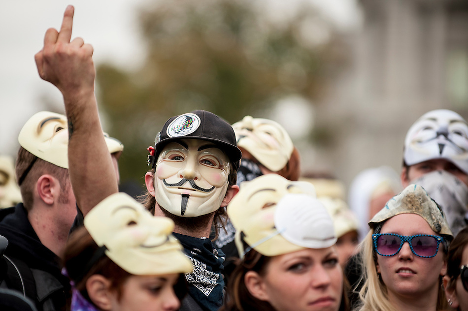 Demonstrators and supporters of the group Anonymous march in front of the U.S. Capitol in Washington, D.C. in protest against corrupt governments and corporations as part of a Million Mask March of similar rallies around the world on Guy Fawkes Day. (Pete Marovich/Corbis)