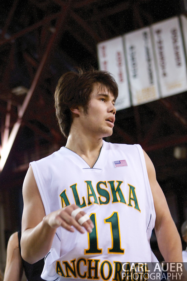 November 25th, 2010:  Anchorage, Alaska - University of Alaska-Anchorage guard Travis Thompson (11) in the Seawolves 54-86 loss to Weber State in the first round of the Great Alaska Shootout. (Carl Auer)