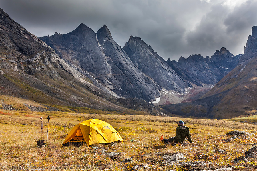 Gates of the Arctic National Park photos: Backpackers enjoy a campsite on the autumn tundra with a view of East and West Maiden and Camel peaks in the distance, Arrigetch Peaks, Gates of the Arctic National Park, Alaska. (Patrick J Endres / AlaskaPhotoGraphics.com)