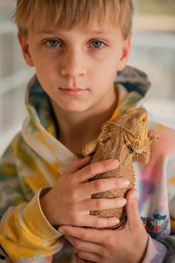 Sam Whelan and his pet Bearded Dragon, Mount Pleassant, S.C. (© Clark James Mishler)