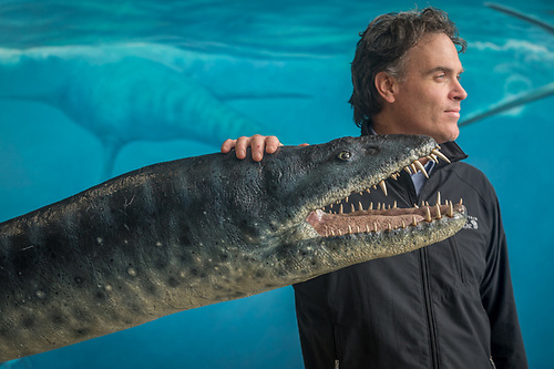 Paleologist and artist James Havens stands with his model of an Elasmosaurus at the Alaska State Fair in Palmer, Alaska. (Clark James Mishler)