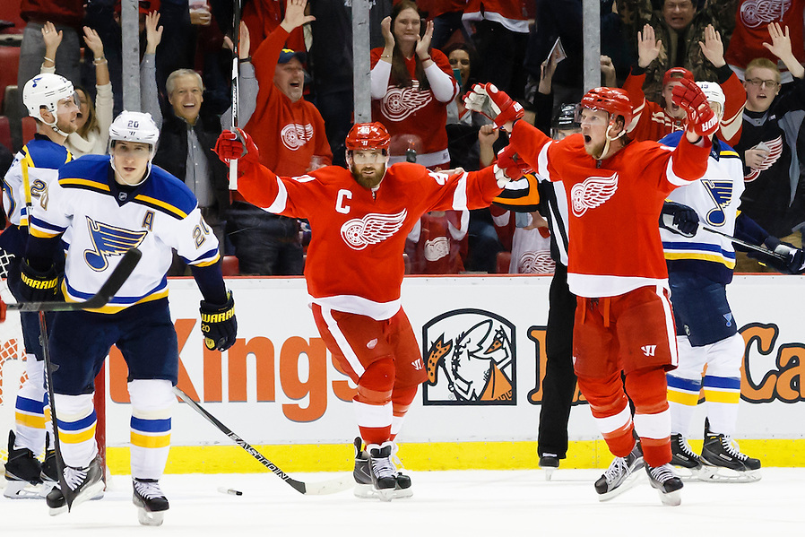 Mar 22, 2015; Detroit, MI, USA; Detroit Red Wings left wing Justin Abdelkader (8) celebrates his goal with left wing Henrik Zetterberg (40) in overtime against the St. Louis Blues at Joe Louis Arena. Detroit won 2-1 in overtime. Mandatory Credit: Rick Osentoski-USA TODAY Sports (Rick Osentoski/Rick Osentoski-USA TODAY Sports)
