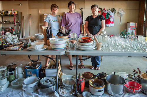 "Objects of a lifetime...""Our father died on April 23rd at age 93...we've come back to Calistoga to clear out the house.""  Cathy, Wendy and Toni, the daughters of Joe Massucco, prepare for tomorrow morning's garage sale. (Clark James Mishler)"