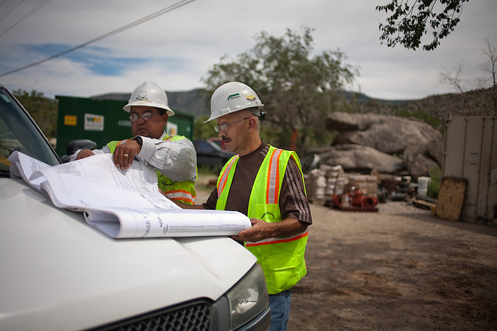 Juan Mata, left, and Esqui Padilla (CQ) go over plans the Carnuel Water Systems Improvement Project on August 27, 2010. The $3.4 million project is supported by $2 million from the American Recovery and Reinvestment Act and will provide clean water to hundreds of Bernalillo County residents. (Steven St. John)