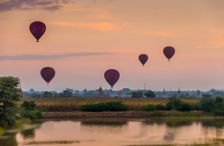 BAGAN, MYANMAR - CIRCA DECEMBER 2013: Hot air balloons flying over the plains of Bagan early morning. (Daniel Korzeniewski)