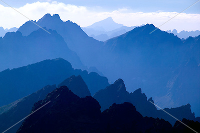 Slovakia, 2006 - The High Tatra mountains fade into the blue high altitude haze. (Alexander Nesbitt)