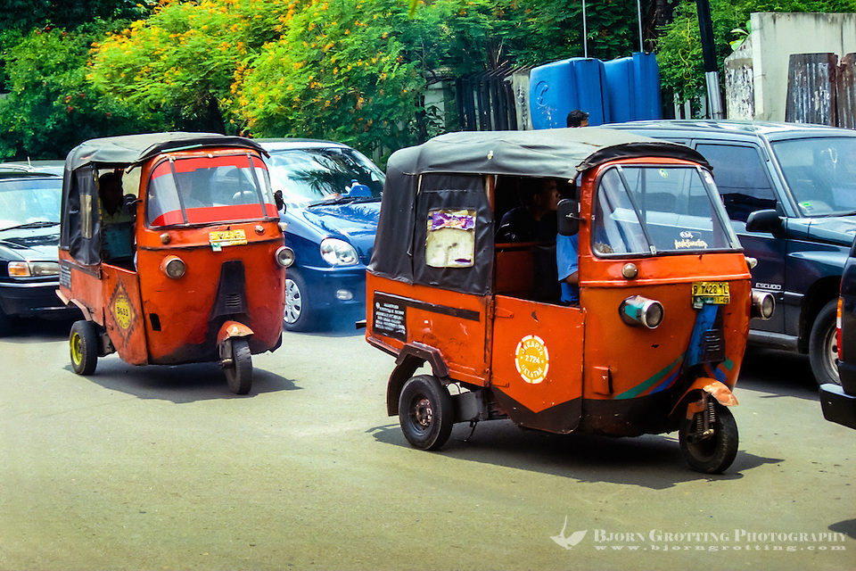 Java, Jakarta. Two Bajaj in Kemang Raya, Jakarta Indonesia. Traffic in Jakarta is often dense, polluted and noisy. (Photo Bjorn Grotting)